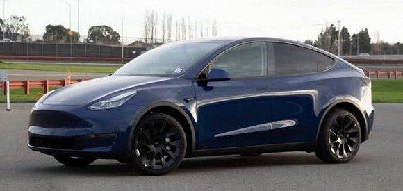 特斯拉发布Model Y量产版实车图:全车无镀铬饰件-企查查